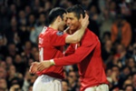 Manchester United's Portuguese midfielder Cristiano Ronaldo (R) celebrates with Welsh midfielder Ryan Giggs after scoring against Inter Milan during their UEFA Champions League second round second leg football match at Old Trafford in Manchester, north west England on March 11, 2009. AFP PHOTO/ANDREW YATES