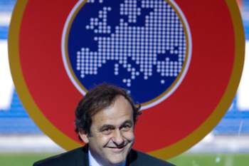 UEFA boss Michel Platini speaks during a tribute to Real Madrid's talismanic forward Alfredo Di Stefano on February 17, 2008. Eighty-one year old Di Stefano received a trophy from UEFA boss Michel Platini. AFP PHOTO/Angel NAVARRETE