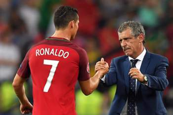 epa05400468 Portugal's head coach Fernando Santos (R) celebrates with Cristiano Ronaldo (L) after the penalty shootout of the UEFA EURO 2016 quarter final match between Poland and Portugal at Stade Velodrome in Marseille, France, 30 June 2016. Portugal won 5-3 on penalties. (RESTRICTIONS APPLY: For editorial news reporting purposes only. Not used for commercial or marketing purposes without prior written approval of UEFA. Images must appear as still images and must not emulate match action video footage. Photographs published in online publications (whether via the Internet or otherwise) shall have an interval of at least 20 seconds between the posting.) EPA/PETER POWELL EDITORIAL USE ONLY