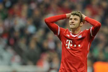 epa04160822 Munich's Thomas Muller reacts during the UEFA Champions League quarter-final second leg soccer match between Bayern Munich and Manchester United in Munich, Germany, 09 April 2014. EPA/ANDREAS GEBERT
