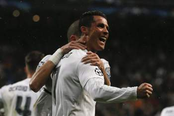 epaselect epa05256035 Real Madrid's Portuguese striker Cristiano Ronaldo jubilates his second goal against Wolfsburg during the UEFA Champions League quarter final second leg match played at Santiago Bernabeu stadium in Madrid, Spain on 12 April 2016.