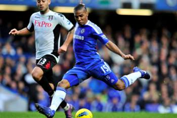 Chelsea's French midfielder Florent Malouda (R) shoots as Fulham's US midfielder Clint Dempsey (L) closes in during the English Premier League football match between Chelsea and Fulham at Stamford Bridge in London, on December 26, 2011. AFP PHOTO/GLYN KIRKRESTRICTED TO EDITORIAL USE. No use with unauthorized audio, video, data, fixture lists, club/league logos or ?live? services. Online in-match use limited to 45 images, no video emulation. No use in betting, games or single club/league/play