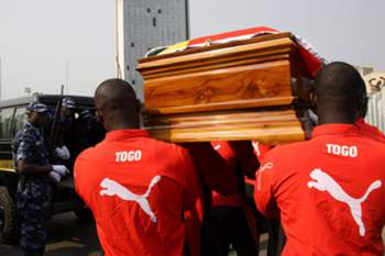 epa01989993 Pallbearers carry the coffin of Togo National soccer team media officer Stanislas Ocloo during his funeral at the Palais des Congres in Lome, Togo 15 January 2010. Occlo was killed when the team came under attack by Angolan rebels in Cabinda, Angola last week. Authorities in Togo declared three days of mourning following the attack on January 08. The Togo team pulled out from the African Cup of Nations tournament following the attack. EPA/STR