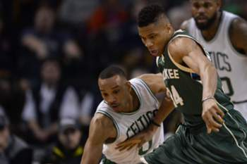 epa05181145 Boston Celtics guard Avery Bradley (L) and Milwaukee Bucks forward Gianni Antetokounmpo of Greece (R) reach for the loose ball during the second half of the game at the TD Garden in Boston, Massachusetts, USA, 25 February 2016. EPA/CJ GUNTHER CORBIS OUT