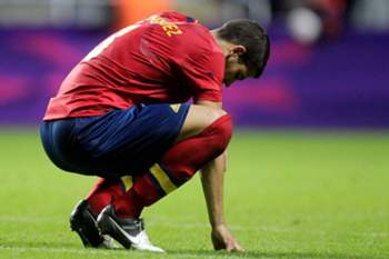 Spain's Alvaro Dominguez reacts after losing 1-0 to Honduras during the London 2012 Olympic Games men's football match Hondurtas against Spain at St James' Park in Newcastle upon Tyne, on July 29, 2012. AFP PHOTO/GRAHAM STUART