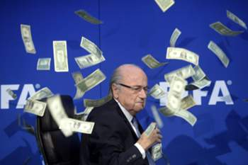 epa04990536 YEARENDER 2015 JULY FIFA president Joseph 'Sepp' Blatter reacts while banknotes thrown by British Comedian Simon Brockin hurtle through the air during a press conference following the extraordinary FIFA Executive Committee at the FIFA headquarters in Zurich, Switzerland, 20 July 2015. EPA/ENNIO LEANZA