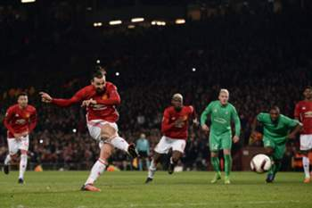Manchester United's Swedish striker Zlatan Ibrahimovic shoots from the penalty spot to score his team's third goal during the UEFA Europa League Round of 32 first-leg football match between Manchester United and Saint-Etienne at Old Trafford stadium in Manchester, north-west England, on February 16, 2017. / AFP PHOTO / Oli SCARFF