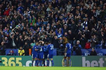 Leicester City's Jamie Vardy is mobbed by team mates after his goal during the English Premier League soccer match between Leicester City and Stoke City at The King Power Stadium in Leicester, Britain, 23 January 2016.
