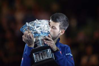 Novak Djokovic of Serbia holds his trophy after winning the Men's Final against Andy Murray of Britain at the Australian Open tennis tournament in Melbourne, Australia, 31 January 2016.