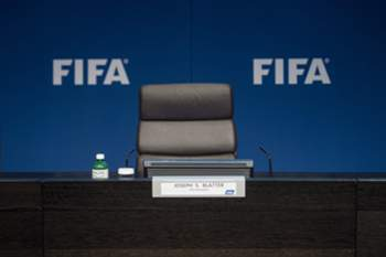 epa04780698 The empty chair of FIFA president Joseph S. Blatter is pictured prior to a press conference at the FIFA headquarters in Zurich, Switzerland, 02 June 2015. FIFA president Joseph S. Blatter at the same event said he is resigning and has called for an extraordinary congress to elect his successor. 'I will organise an extraordinary congress for a replacement for me as president,' Blatter said at the hastily convened press conference in Zurich. EPA/ENNIO LEANZA