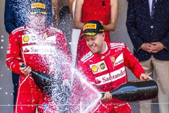 epa05995598 German Formula One driver Sebastian Vettel (R) of Scuderia Ferrari celebrates on the podium after winning the Monaco Formula One Grand Prix at the Monte Carlo circuit in Monaco, 28 May 2017. EPA/SRDJAN SUKI