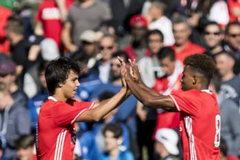 epa05919591 Benfica's Joao Felix (L) celebrates after scoring a goal with his teammate Gedson Fernandes (R) during the UEFA Youth League semi final match between Real Madrid CF and SL Benfica at the Colovray Sports Centre stadium, in Nyon, Switzerland, 21 April 2017.