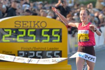 Russia's Albina Mayorova crosses the finish line to win the Yokohama Women's Marathon on November 17, 2013. Mayorova won the event in 2 hours, 25 minutes, 55 seconds. AFP PHOTO / KAZUHIRO NOGI