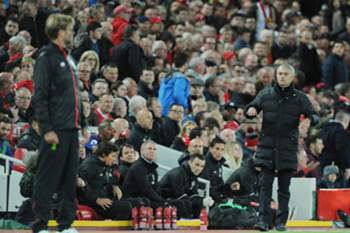 epa05589630 Manchester United manager Jose Mourinho (R) reacts with Liverpool Manager Juergen Klopp (L) during the English Premier League soccer match between Liverpool and Manchester United at Anfield, Liverpool, Britain, 17 October 2016.
