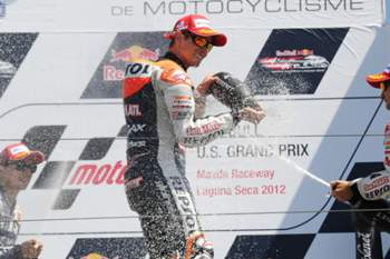 Repsol Honda Team rider Casey Stoner (C) of Australia, Yamaha Factory Racing team rider Jorge Lorenzo (L) of Spain and Repsol Honda team rider Dani Pedrosa of Spain celebrate with champagne after the Red Bull U.S. Moto GP race at Mazda Raceway Laguna Seca in Monterey, California, July 29 2012. Stoner finished first followed by Lorenzo and Pedrosa. AFP PHOTO / ROBYN BECK
