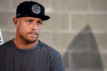 epa04855010 Australian professional surfer Mick Fanning appears to be pensive as he attends a news briefing in Sydney, Australia, 21 July 2015. Fanning is en-route to his home on the Gold Coast after he was attacked by a large shark while waiting to catch a wave in a surf competition in Jeffreys Bay near Port Elizabeth, South Africa, on 19 July 2015. EPA/DEAN LEWINS AUSTRALIA AND NEW ZEALAND OUT