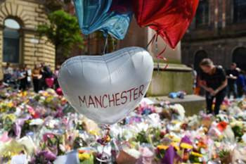 epa05986577 Tributes lie in St. Ann's Square for the people who lost their lives during the Manchester terror attack in central Manchester, Britain, 24 May 2017. Britain is on critical alert following the Manchester terror attack on the Manchester Arena late 22 May, that saw 22 people loose their lives with scores of people injured. The government has indicated that the military are to be deployed on the streets along side the police.