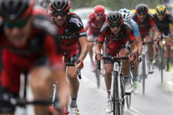 Australia's Richie Porte (3rdL) rides with his teammates of the USA's BMC Racing cycling team during the 146 km nineteenth stage of the 103rd edition of the Tour de France cycling race on July 22, 2016 between Albertville and Saint-Gervais Mont Blanc, French Alps. / AFP PHOTO / KENZO TRIBOUILLARD