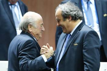 UEFA President Michel Platini (R) congratulates FIFA President Sepp Blatter after he was re-elected at the 65th FIFA Congress in Zurich, Switzerland, May 29, 2015. Sepp Blatter has been re-elected as FIFA president for a fifth term after Jordan's Prince Ali bin Al Hussein conceded defeat at the Congress of world football's governing body on Friday. REUTERS/Arnd Wiegmann TPX IMAGES OF THE DAY - RTR4Y2C8