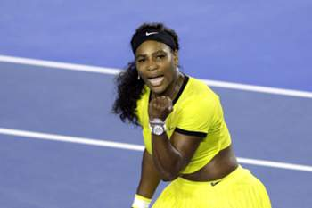 epa05130509 Serena Williams of the US reacts as she plays against Agnieszka Radwanska of Poland during their semi finals round on day eleven of the Australian Open tennis tournament in Melbourne, Australia, 28 January 2016. EPA/LYNN BOBO