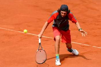epa05420425 Pedro Sousa of Portugal returns the ball to Gleb Sakharov of France during their first round match at the Challenger ATP tennis tournament in Poznan, Poland, 11 July 2016. EPA/Jakub Kaczmarczyk POLAND OUT
