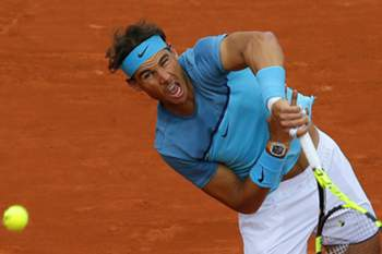 epa05326722 Rafael Nadal of Spain in action against Sam Groth of Australia during their men's single first round match at the French Open tennis tournament at Roland Garros in Paris, France, 24 May 2016. EPA/ROBERT GHEMENT