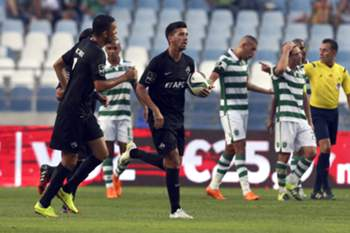 Académica´s Rabiola (C) celebrates the scoring of a goal against Sporting Lisbon´s during their Portuguese First League soccer match held at Cidade de Coimbra Stadium, Coimbra, Portugal, 30th August 2015.