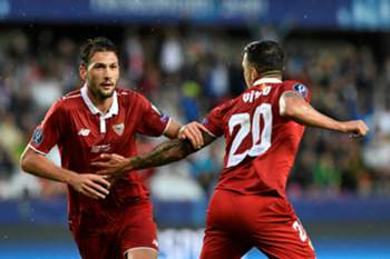 Sevilla's Argentinian midfielder Franco Vazquez (L) and Sevilla's Spanish midfielder Vitolo celebrate during the UEFA Super Cup final football match between Real Madrid CF and Sevilla FC on August 9, 2016 at the Lerkendal Stadium in Trondheim.