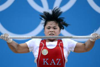 Zulfiya Chinshanlo of Kazakhstan wins the Women's 53kg Group A of the weightlifting event at ExCeL Arena at the London 2012 Olympic Games, London, Great Britain, 29 July 2012.