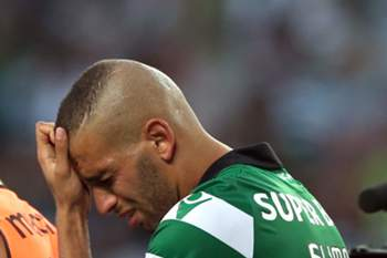 Sporting Lisbon player Slimani cries in the end of the Portuguese First League soccer match with FC Porto held at Alvalade Stadium in Lisbon, Portugal, 28th August 2016.