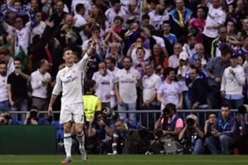 Real Madrid's Portuguese forward Cristiano Ronaldo celebrates a goal during the UEFA Champions League semifinal first leg football match Real Madrid CF vs Club Atletico de Madrid at the Santiago Bernabeu stadium in Madrid, on May 2, 2017. / AFP PHOTO / JAVIER SORIANO