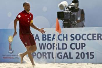 Portugal's player Madjer celebrates a goal against Switzerland´s during the FIFA Beach Soccer World Cup Portugal 2015 quarter-finals between Portugal and Switzerland at Espinho stadium, in Espinho, North of Portugal, 16 July 2015. ESTELA SILVA/LUSA