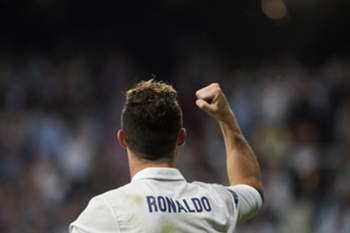 Real Madrid's Portuguese forward Cristiano Ronaldo celebrates after scoring his third goal during the UEFA Champions League semifinal first leg football match Real Madrid CF vs Club Atletico de Madrid at the Santiago Bernabeu stadium in Madrid, on May 2, 2017. Real won 3-0. / AFP PHOTO / CURTO DE LA TORRE