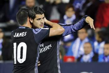 Real Madrid's striker Alvaro Morata (R) celebrates with his teammate James Rodriguez (L) after scoring a goal during the Spanish Primera Division soccer match between CD Leganes and Real Madrid at Butarque stadium in Madrid, Spain, 05 April 2017.