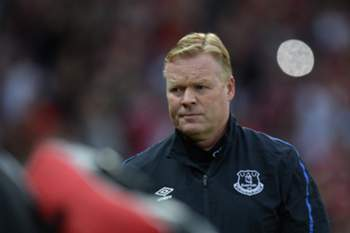Everton's Dutch manager Ronald Koeman arrives for the friendly Wayne Rooney testimonial football match between Manchester United and Everton at Old Trafford in Manchester, northwest England, on August 3, 2016. / AFP PHOTO / OLI SCARFF