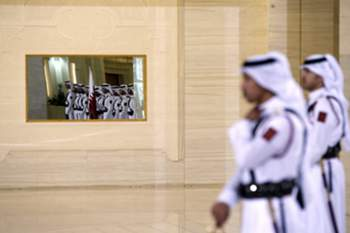 epa04732432 Qatari guards attend a ceremony with French President, Francois Hollande (not pictured), and Qatar's Emir, Sheikh Tamim bin Hamad al-Thani (not pictured), at the Diwan Palace in Doha, Qatar, 04 May 2015. In an attempt to boost regional ties with the Gulf, Hollande will sign a 7-billion-euro Rafale fighter jet deal with Qatar, the third high profile sale of France's delta-winged Rafale, manufactured by Dassault Aviation, before the French President flies to Saudi Arabia to take a central role in the upcoming GGC Summit, where the situation in Yemen is expected to be discussed, as a Saudi led coalition continues military operations. EPA/CHRISTOPHE ENA / POOL MAXPPP OUT