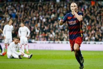 Andres Iniesta (R) celebrates after scoring the 0-3 lead against Real Madrid during the Spanish Liga Primera Division soccer match played at Santiago Bernabeu stadium in Madrid, Spain, 21 November 2015.