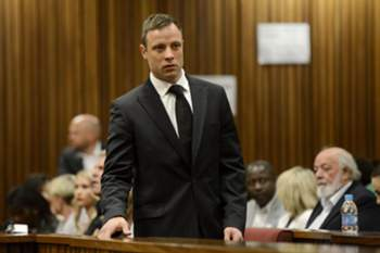 epa04455628 South African Paralympic athlete Oscar Pistorius arrives in court on day six of sentencing procedures at the High Court in Pretoria, South Africa, 21 October 2014. Pistorius was last month found guilty of the culpable homicide of his model girlfriend Reeva Steenkamp on 14 February 2013. Judge Thokozile Masipa delivered sentence following aggravating and mitigating arguments from the defence and prosecution. EPA/HERMAN VERWEY/POOL