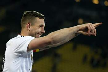 epa05864683 Lukas Podolski of Germany gestures to fans after the international friendly soccer match between Germany and England in Dortmund, Germany, 22 March 2017. Podolski was playing his 130th and final cap for Germany today. EPA/RONALD WITTEK