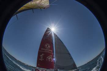 epa04748797 A picture taken with a fish eye lens shows Dongfeng Race Team sails past during an in-port sail, in Newport Harbor, off the coast of Newport, Rhode Island, USA 14 May 2015. Abu Dhabi Ocean Racing and six other vessels are currently on a layover in Newport, while competing in the Volvo Ocean Race around the globe.