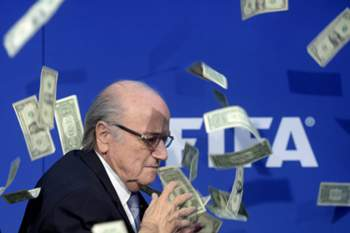 epa04854272 CAPTION CORRECTION for epa04854261 epa04854260 epa04854246 epa04854241 = Corrects spelling of British comedian from Brockin to Brodkin = FIFA president Joseph 'Sepp' Blatter reacts while banknotes thrown by British Comedian Simon Brodkin hurtle through the air during a press conference following the extraordinary FIFA Executive Committee at the FIFA headquarters in Zurich, Switzerland, 20 July 2015. During the extraordinary FIFA Executive Committee meeting the agenda for the elective Congress for the FIFA-presidency will be finalised and approved. EPA/ENNIO LEANZA CAPTION CORRECTION: Corrects spelling of comedian from Brockin to Brodkin