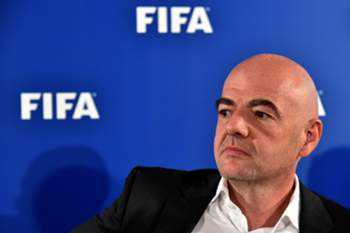 FIFA president Gianni Infantino looks on as he gives a press conference on September 2, 2016 at San Nicola stadium in Bari, about the Video Assistant Referee (VAR), tested for the first time the day before during the friendly football match Italy vs France. Video refereeing was trialled for the first time in an international match, during the friendly between Italy and France on September 1 in Bari. An extra assistant referee on the sidelines was able to communicate with the on-pitch referee during the game. The tests have the support of the IFAB, the body who govern the rules of the game. Video tests have been ongoing in the third tier of the United States since July. / AFP PHOTO / ALBERTO PIZZOLI
