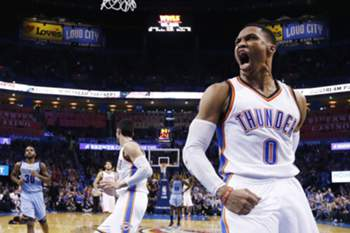 epaselect epa05711964 Oklahoma City Thunder guard Russell Westbrook (R) reacts after dunking the ball in the second half of the NBA basketball game between the Memphis Grizzlies and the Oklahoma City Thunder at the Chesapeake Energy Arena in Oklahoma City, Oklahoma, USA, 11 January 2017.