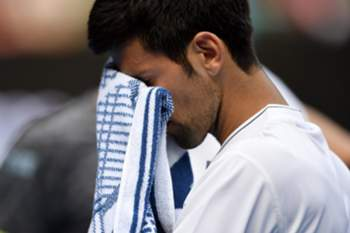 epa05729947 Novak Djokovic of Serbia reacts after losing against Denis Istomin of Uzbekistan during round two of the Men's Singles at the Australian Open Grand Slam tennis tournament in Melbourne, Victoria, Australia, 19 January 2017. EPA/FILIP SINGER