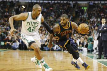 epa05823867 Cleveland Cavaliers guard Kyrie Irving (R) drives around the defending Boston Celtics center Al Horford (L) during the first half of their NBA game at TD Garden in Boston, Massachusetts, USA, 01 March 2017. EPA/CJ GUNTHER