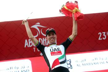 epa05814703 Portuguese rider Rui Costa of the UAE Team Emirates celebrates on the podium after winning third stage of the Abu Dhabi Tour cycling race, 25 February 2017. EPA/MATTEO BAZZI
