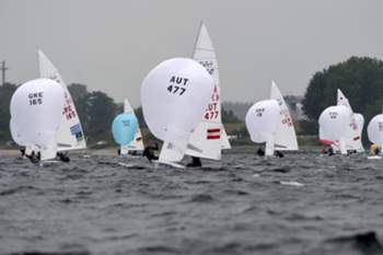 epa04813939 Ships of the 470 class during a regatta of the Kiel Week on the Baltic Sea near Kiel, Germany, 22 June 2015. Around three million visitors are expected to attend the world's biggest sailing event held from 20 June to 28 June 2015. EPA/CARSTEN REHDER