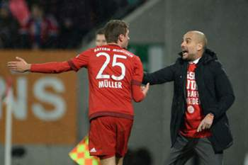 Thomas Müller e Pep Guardiola