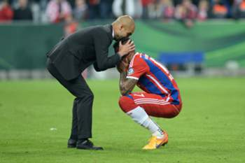 Bayern Munich's Spanish headcoach Pep Guardiola (L) comforts Bayern Munich's defender Jerome Boateng after the German Cup DFB Pokal semi-final football match FC Bayern Munich v Borussia Dortmund in Munich, southern Germany, on April 28, 2015. Dortmund won the match 1-3 after penalties. AFP PHOTO / CHRISTOF STACHE +++ RESTRICTIONS / EMBARGO – ACCORDING TO DFB RULES IMAGE SEQUENCES TO SIMULATE VIDEO IS NOT ALLOWED DURING MATCH TIME. MOBILE (MMS) USE IS NOT ALLOWED DURING AND FOR FURTHER TWO HOURS AFTER THE MATCH. FOR MORE INFORMATION CONTACT DFB DIRECTLY AT +49 69 67880