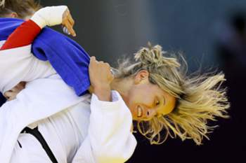 epa04818234 Telma Monteiro (white) of Portugal competes against Automne Pavia (blue) of France in the Women's 57 kg Judo Semifinals at the Baku 2015 European Games in Azerbaijan, 25 June 2015. EPA/ROBERT GHEMENT